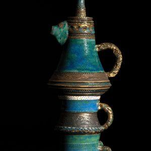 Porcelana - modelagem em torno e manual, esmaltação, queima em oxidação a 1240º centígrados